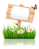 Nature background with grass and sign and a paper. Royalty Free Stock Photo