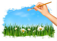 Nature background with hand holding a brush Stock Image