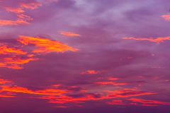 Nature background. Red sky at night and clouds. Beautiful and co Stock Image