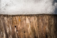Nature background of stump with snow on it. Stock Photos