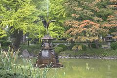 Nature background with view of traditional Japanese garden. In Hibiya public park in Tokyo, Japan, with pond, trees, and water reflections in November stock photos