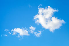 Nature background, white clouds in a blue sky Royalty Free Stock Photo