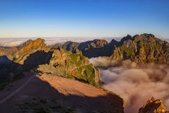 Free Nature Background With Sunrise Over Clouds. It Is On The Top Of Pico Do Arieiro Mountain, Madeira Island, Portugal. The Mountains Stock Images - 165488444