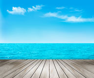 Nature background with a wooden deck, the sea and the sky. Royalty Free Stock Photo