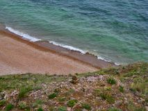 Nature Of Baikal. The sandy beach and the waves Royalty Free Stock Photo
