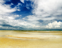 Beautiful sky and beach at low tide Stock Photography