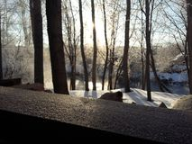 Nature. Beautiful sunrise, foggy morning over the river.The sun`s rays, shining through the frosty mist Stock Photo