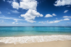 Beautiful tropical beach and blue sky Royalty Free Stock Image