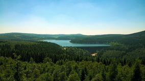 Nature. Really beautiful view to water tank Fláje in the Krušné mountains, nice green forest and clear blue sky. View from place named snake rock. Czech stock photos