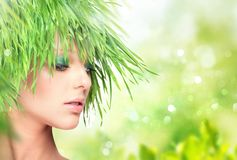 Nature beauty woman with fresh grass hair. Nature beauty woman with fresh grass instead of hair royalty free stock image