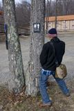 When nature calls. Man urinating under the tree stock photo