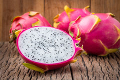 Free Nature Can Be Pretty Weird Sometimes, Dragon-fruit Are Nutritious Tropical Fruit That Way Your Fruits Setup On Wooden Background. Stock Photos - 75180463