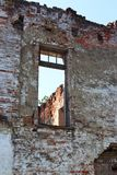 Blue sky in empty windows of Picturesque ruins of an old mansion. Abandoned place. royalty free stock photo