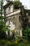 Nature captures the ruined house. House abandoned by people. Tkvarcheli. Nature captures the ruined house. House abandoned by people stock photography
