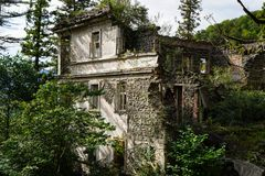 Nature captures the ruined house. House abandoned by people. Tkvarcheli royalty free stock photos