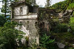 Nature captures the ruined house. House abandoned by people. Tkvarcheli. Nature captures the ruined house. House abandoned by people stock photo