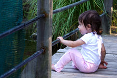 child on a bridge Stock Photography