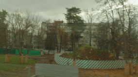 Nature of city on cloudy autumn afternoon from window of moving train. Of MCC stock video