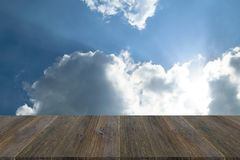 Blue sky cloud with Wood terrace. Nature cloudscape with blue sky and white cloud with Wood terrace Royalty Free Stock Photography