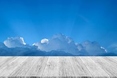 Blue sky cloud with Wood terrace. Nature cloudscape with blue sky and white cloud with Wood terrace Stock Photo