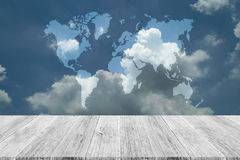 Blue sky cloud with Wood terrace and world map Royalty Free Stock Image