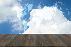 Blue sky cloud with Wood terrace and world map Stock Photos
