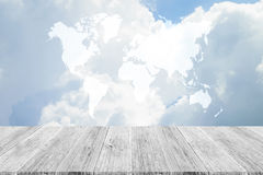Blue sky cloud with Wood terrace and world map Stock Photography