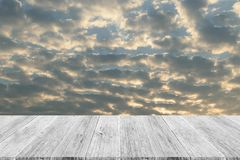 Red sky cloud with Wood terrace Royalty Free Stock Photo
