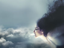 Nature concept, clouds and wind. Beautiful brunette, Healthy Lon Stock Images