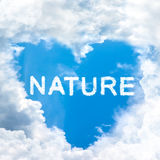 Nature concept word inside sky heart shaped by cloud Royalty Free Stock Photos