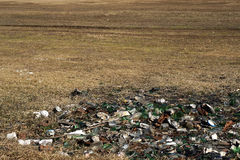 Nature contaminated by glass metal plastic waste -  Pollution  Royalty Free Stock Photography