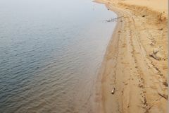 Curve of the beach, gold sandy at Thailand. The nature curve of the beach at estuary, Gold sand and sea, East of Thailand royalty free stock image