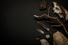 Nature details collection - stones, feathers, tree bark and branch on black Royalty Free Stock Photo