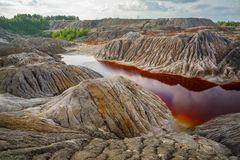 Nature disaster, lifeless land with polluted water royalty free stock image