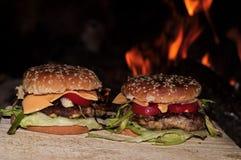 Burger and fire stock photos