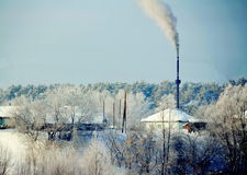 Nature and ecology. Highly over the city the factory pipe smokes Stock Photo