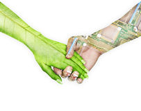 Nature and electronics holding hands in sky background Stock Photo