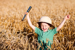Nature explorer. Portrait of young nature explorer in wheat field Stock Photo
