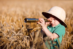 Nature explorer. Portrait of young nature explorer in wheat field Royalty Free Stock Photo