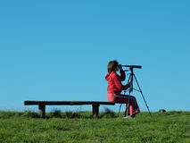 Nature Explorer. Girl exploring the mountain landskape with spyglass stock image