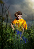 Nature. Fashion model standing in evening field Royalty Free Stock Photos