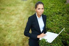 Nature friendly businesswoman Stock Photo