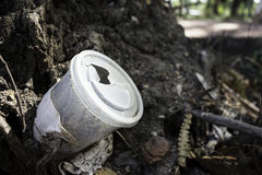 Nature Garbage. A wasted plastic coffee cup in the nature Royalty Free Stock Photo