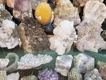 Stones with quartz minerals in various colors, background and texture. Nature and geology, mining in the state of Guanajuato, stones with shine for energy royalty free stock photography