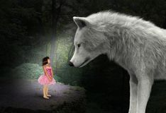 Nature, Girl, Wolf, Woods, Forest, Surreal. Surreal scene of a young girl in the woods or forest with a giant white wold. Abstract concept for peace, love royalty free stock photography