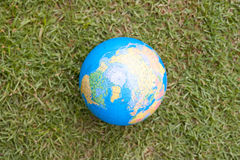 Nature globe. An image of a globe on carpet grass stock images