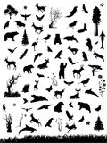 Nature Graphics. Silhouetted graphic of animals, trees, flowers and insects stock illustration