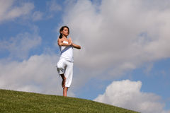 Nature harmony. Woman meditating at the park in harmony with nature Royalty Free Stock Photo