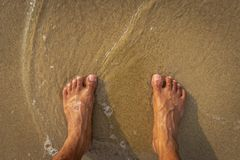 Nature Healing power with foot and sand view stock photos