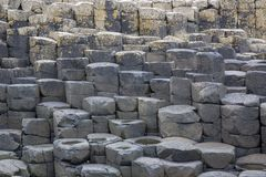 The nature hexagon stones at the beach called Giant`s Causeway, the landmark in Northern Ireland. United kingdom stock photo